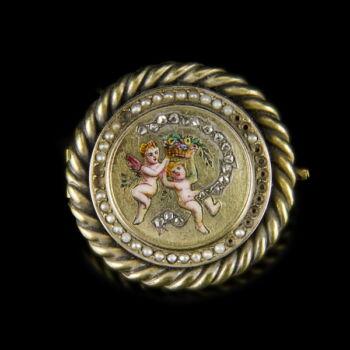 Arany bross puttókkal gyémántokkal és gyönggyel