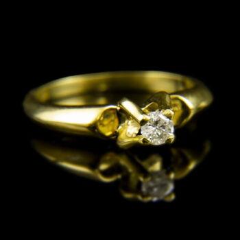 18 karátos sárgaarany eljegyzési gyűrű briliáns csiszolású gyémánt kővel (0.16 ct)