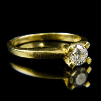 14 karátos arany eljegyzési gyűrű briliáns csiszolású gyémánt kővel (0.70 ct)