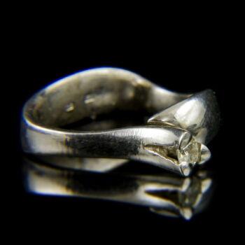14 karátos fehérarany eljegyzési gyűrű briliáns csiszolású gyémánt kővel (0.15 ct)