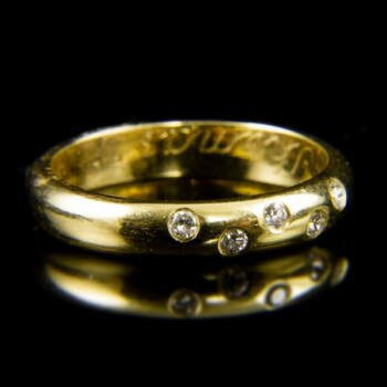 14 karátos sárgaarany kaulgyűrű apró gyémánt kövekkel