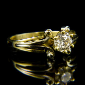 14 karátos sárgaarany szoliter gyűrű briliáns csiszolású gyémánt kővel (0.65 ct)