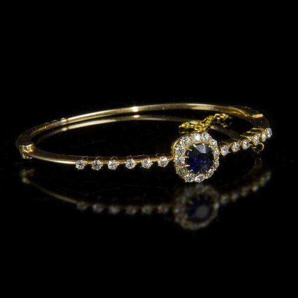 14 karátos arany karkötő zafír és gyémánt kövekkel