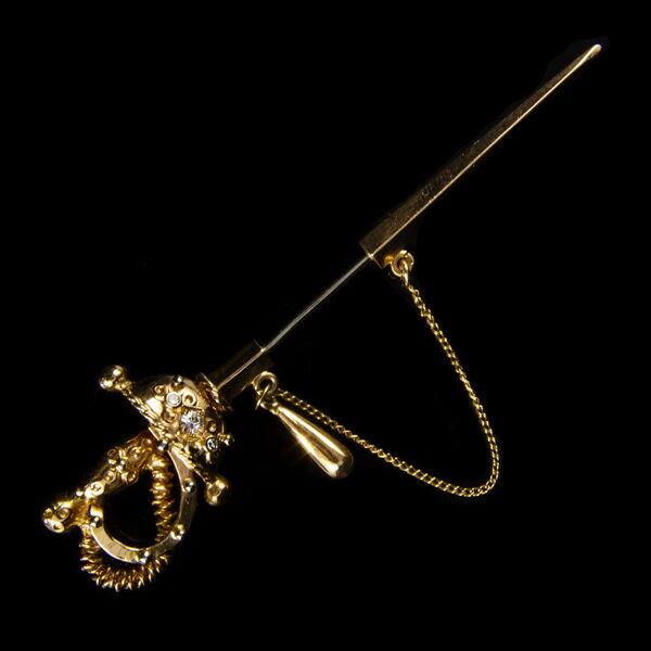 Kard alakú arany kitűző brillekkel