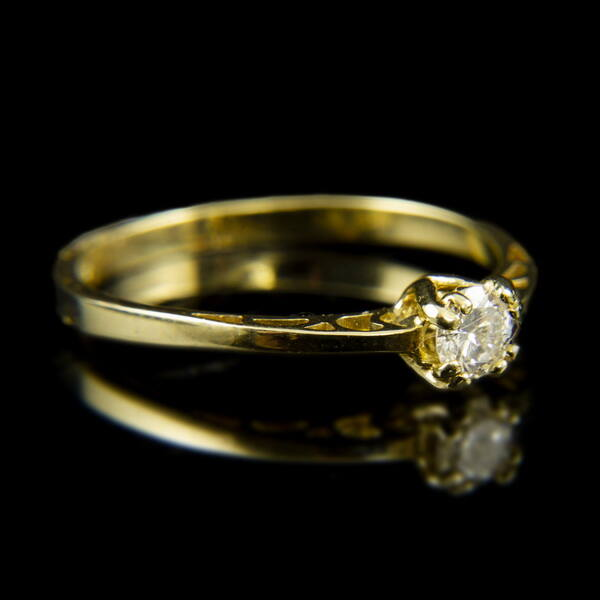 14 karátos sárgaarany eljegyzési gyűrű gyémánt kővel (0.21 ct)