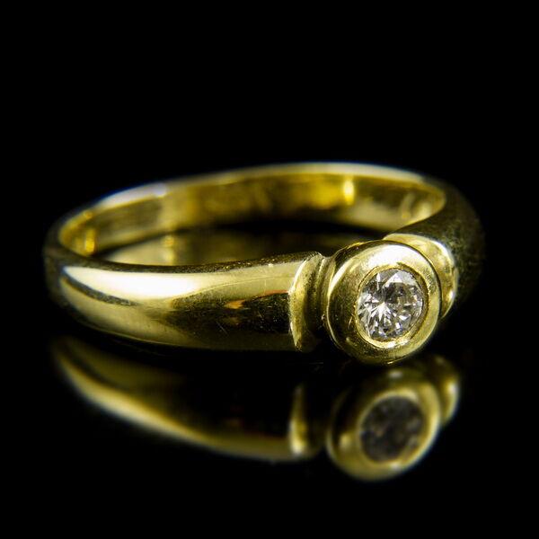 14 karátos sárgaarany szoliter gyűrű bouton foglalatban gyémánt kővel (0.19 ct)